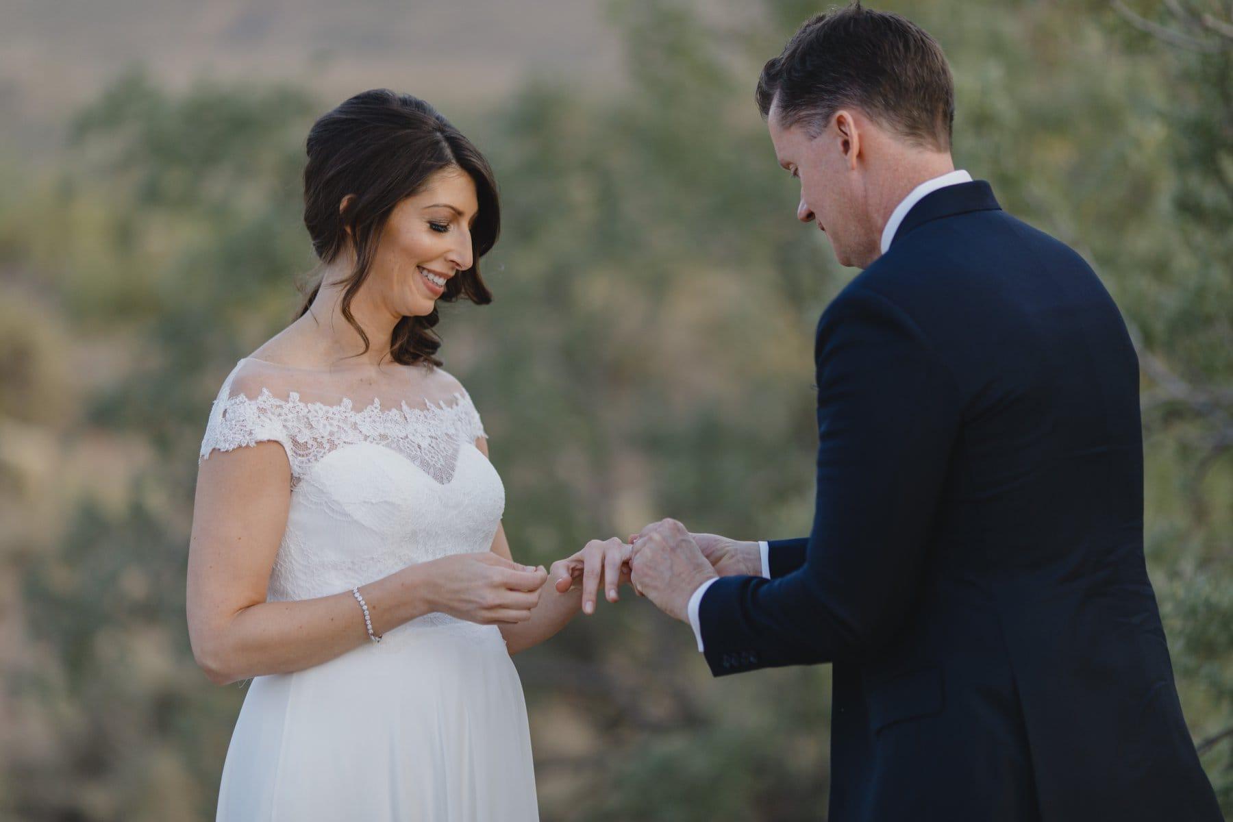 exchanging rings Arizona elopement in the desert