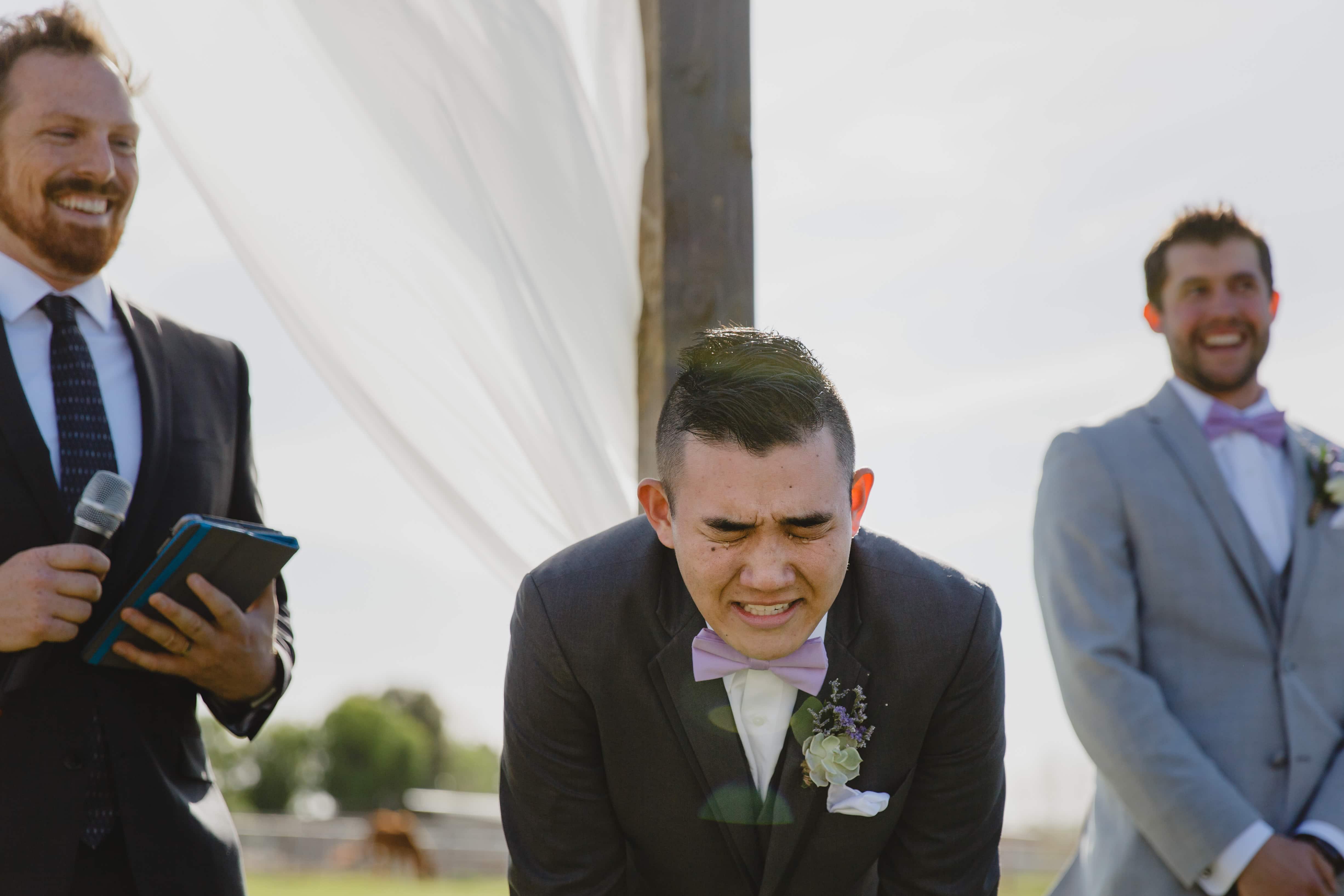 emotional crying groom seeing bride walk down aisle