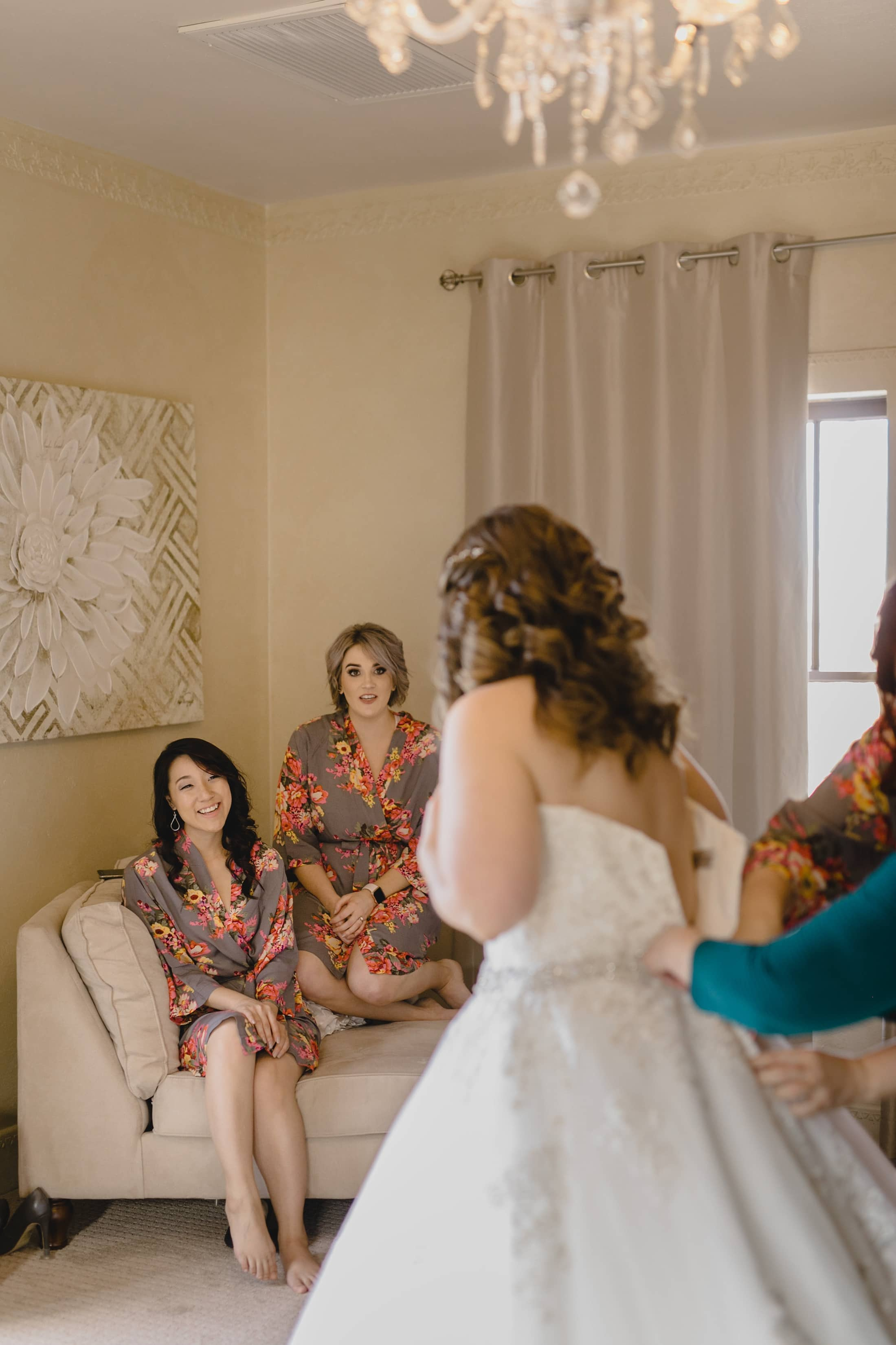 bridesmaids seeing bride in dress for first time Phoenix wedding photographer