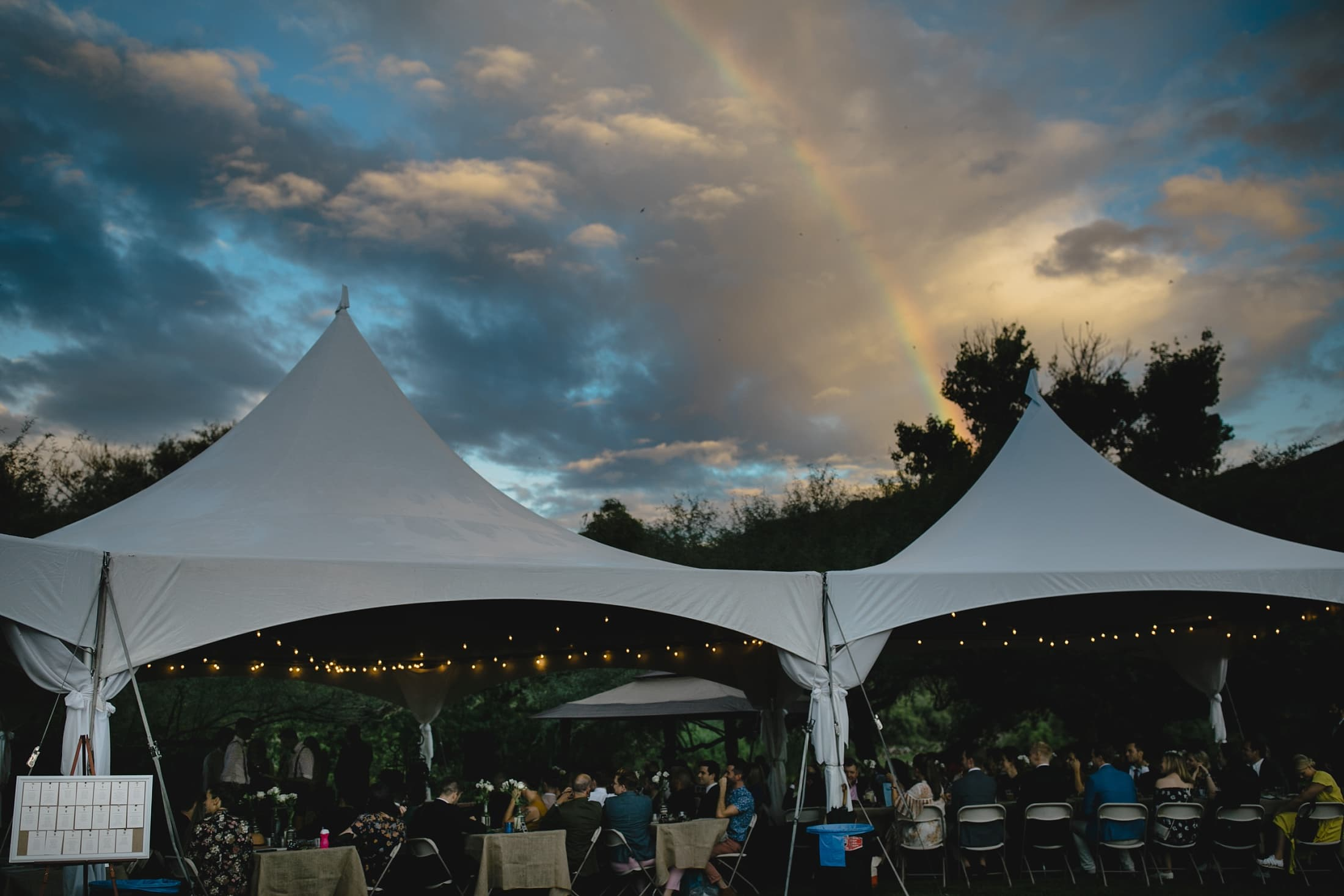 Saguaro Lake Ranch wedding under tents with rainbow