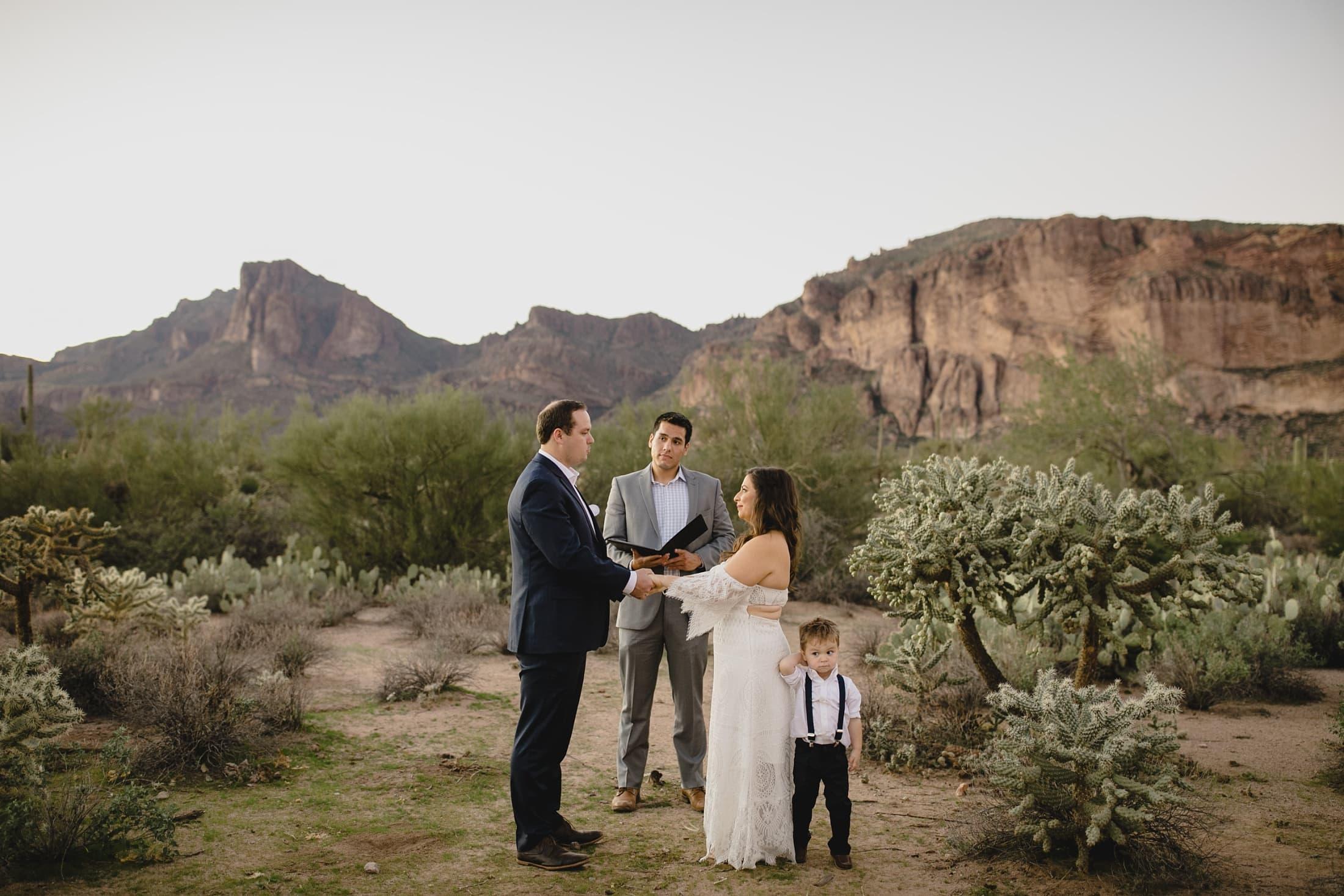 small wedding in Arizona desert bride and groom with kid