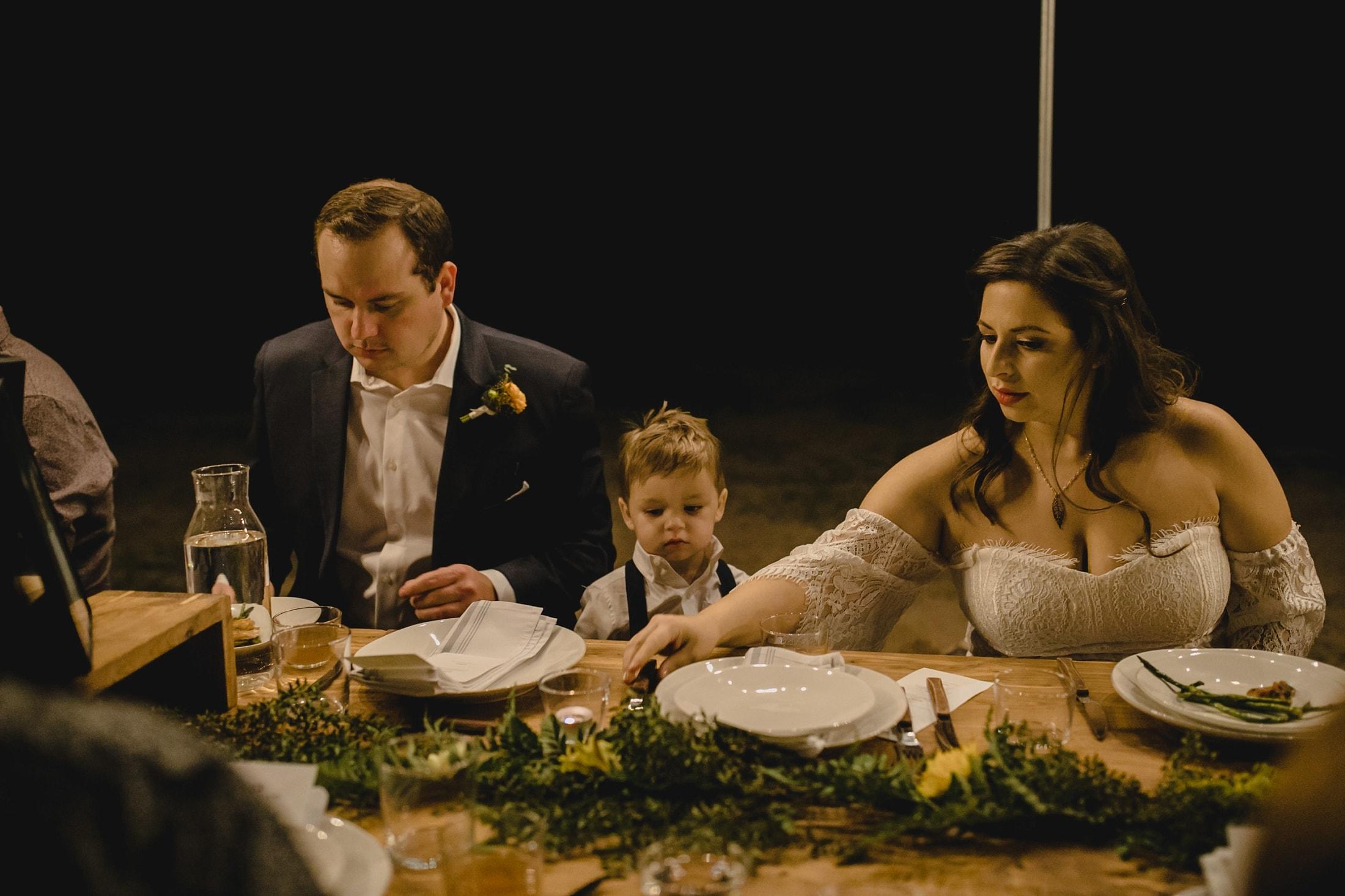 wedding reception outdoors under string lights in Arizona desert
