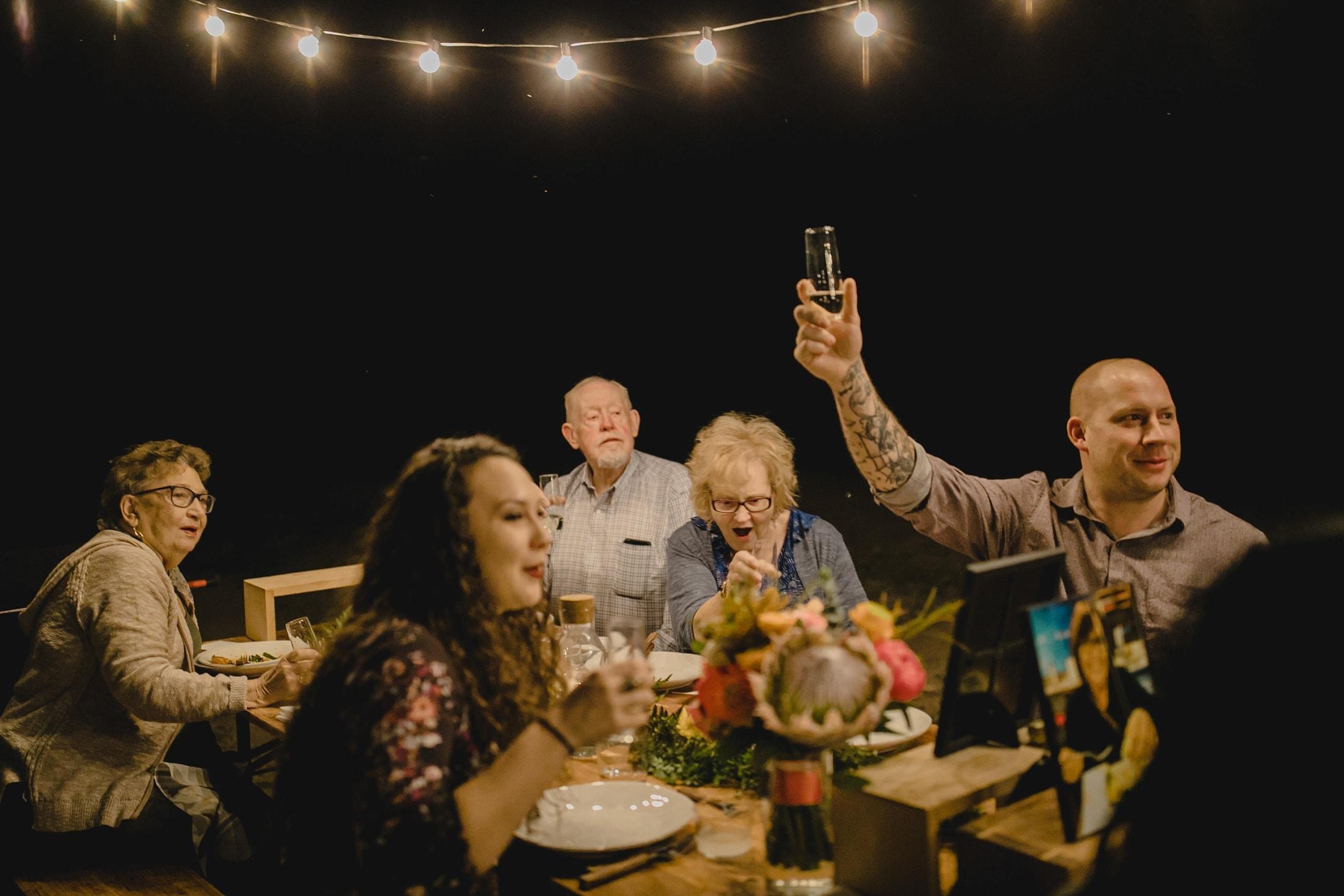 wedding reception toast under string lights Cloth & Flame Arizona