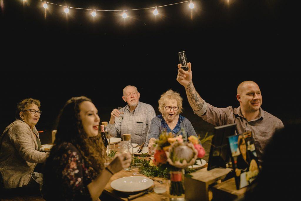 small wedding reception under string lights Superstition Mountains Arizona