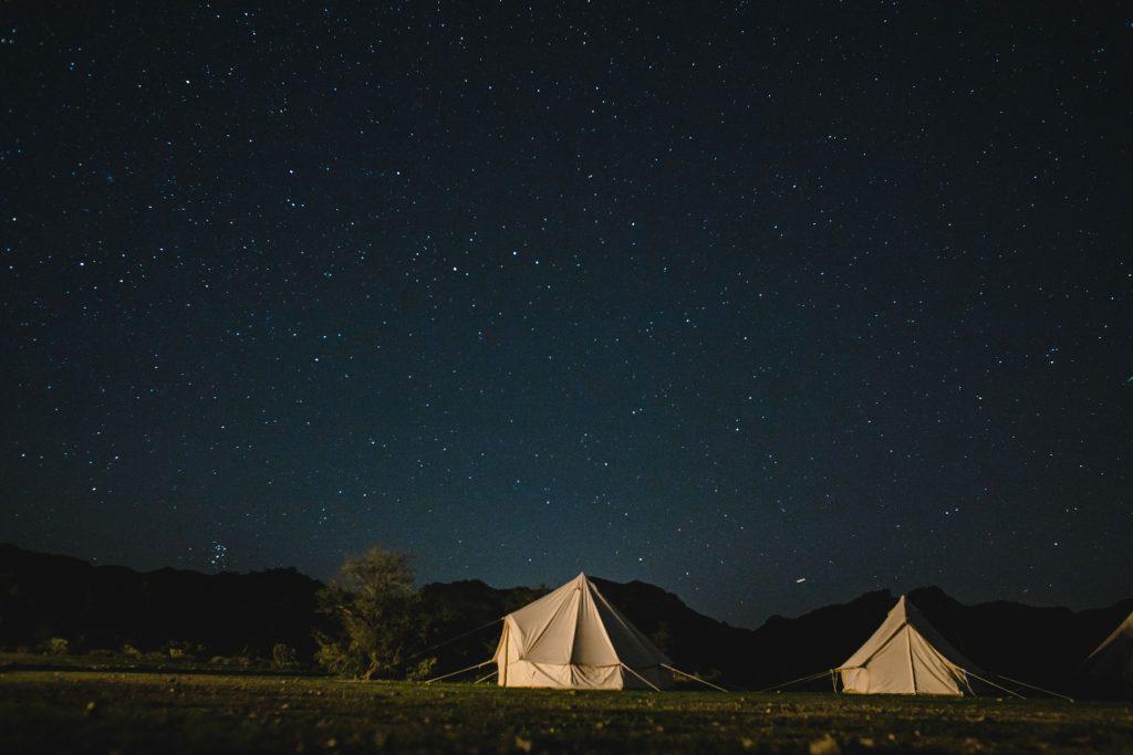 tent camping wedding under night sky in Arizona