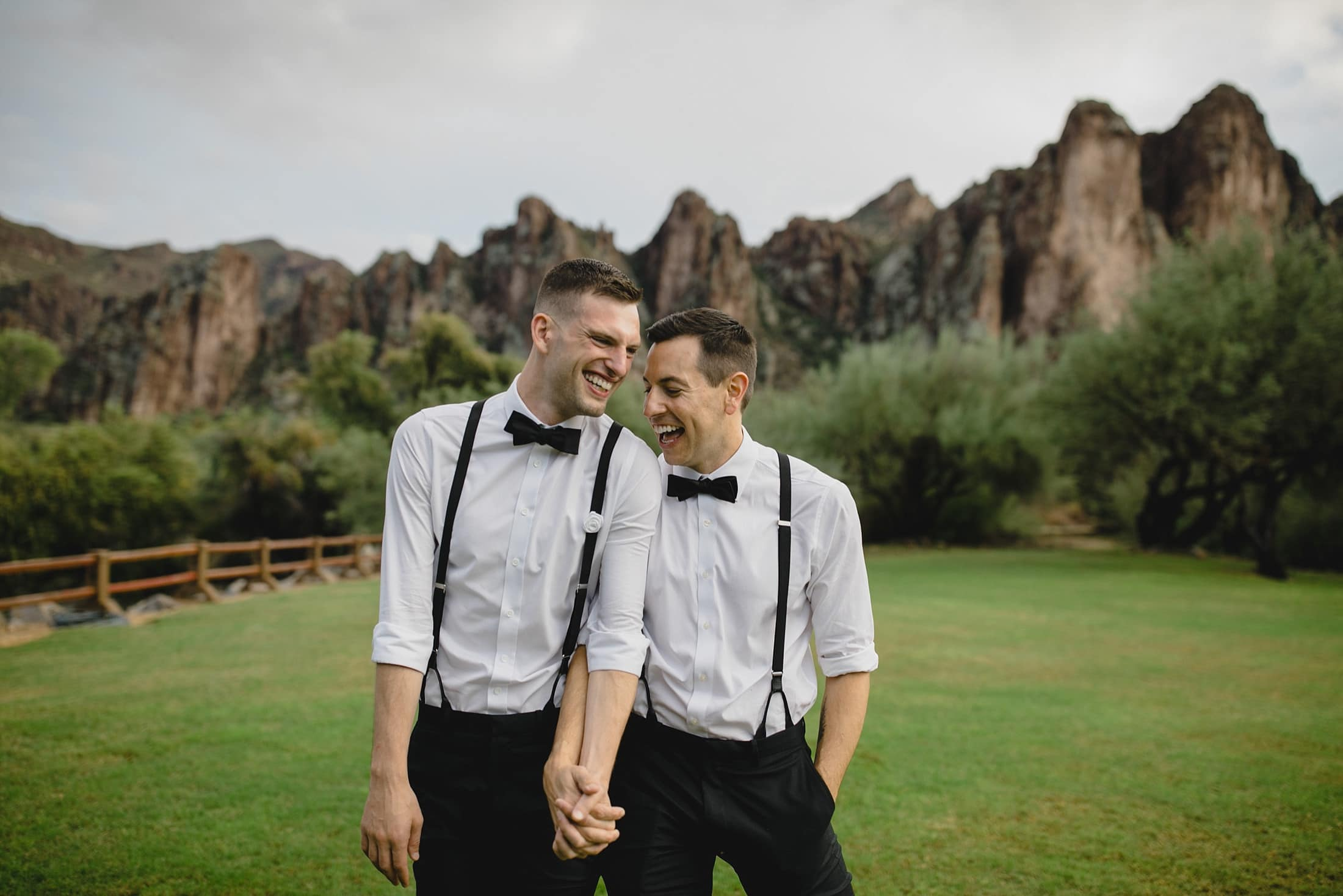 gay couple in matching black and white dress shirts with suspenders at Saguaro Lake Ranch Arizona