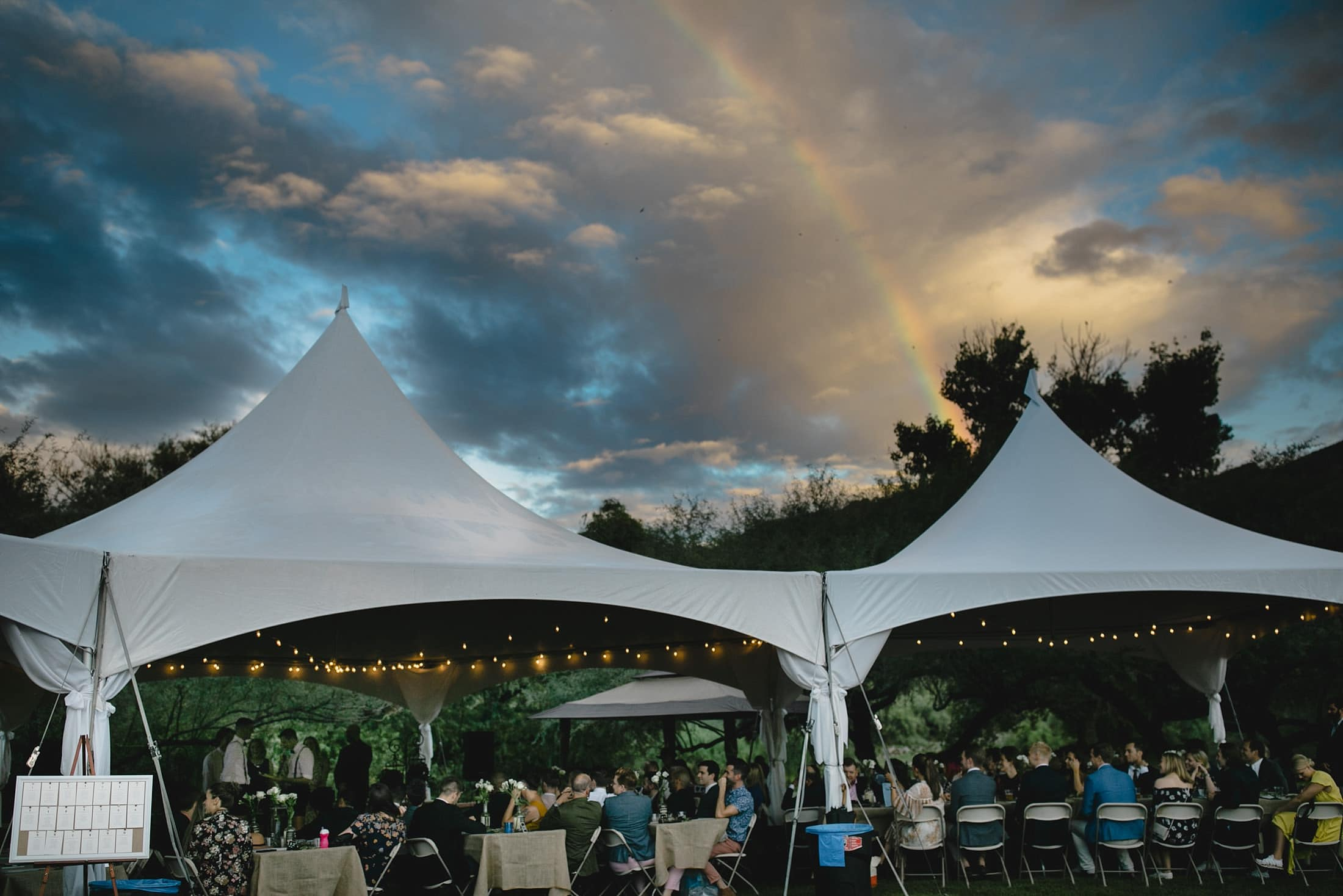 Saguaro Lake Ranch tented reception with rainbow gay wedding