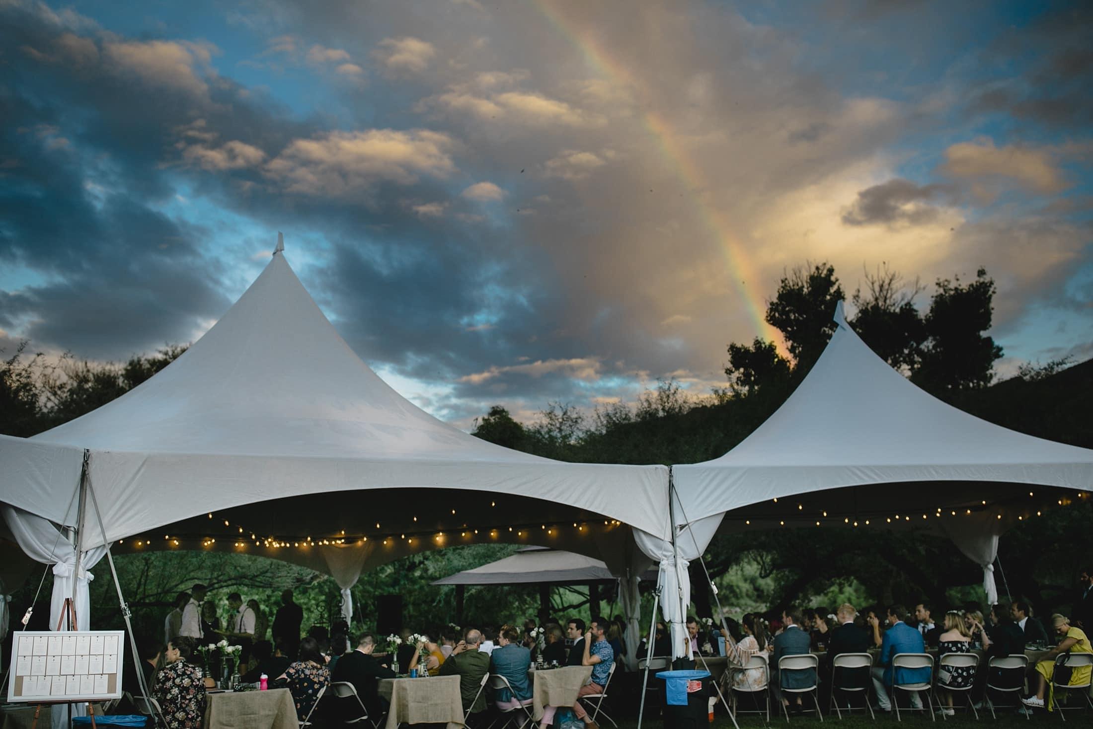 Saguaro Lake Ranch tented reception with rainbow gay wedding