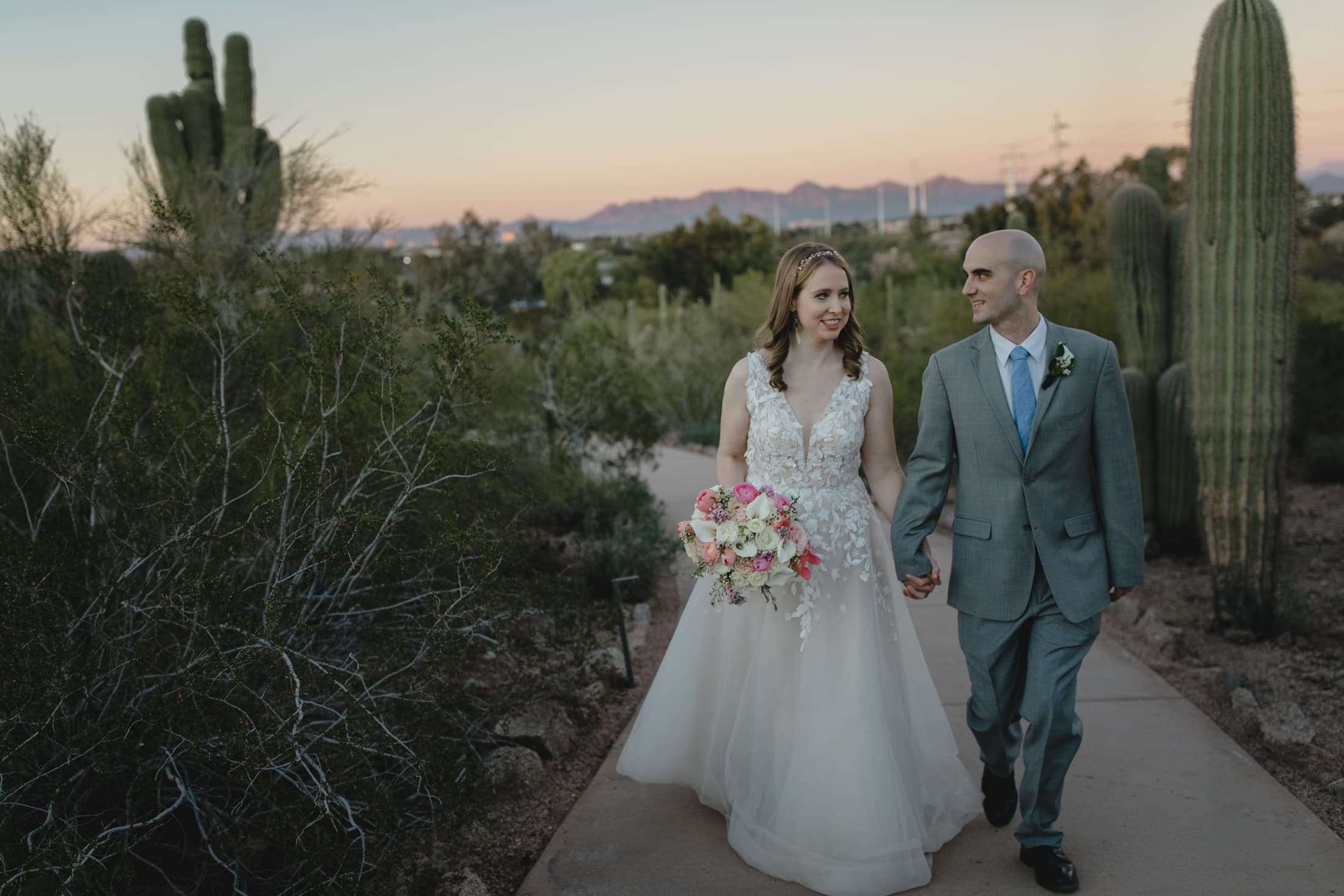 Desert Botanical wedding bride and groom walking on path