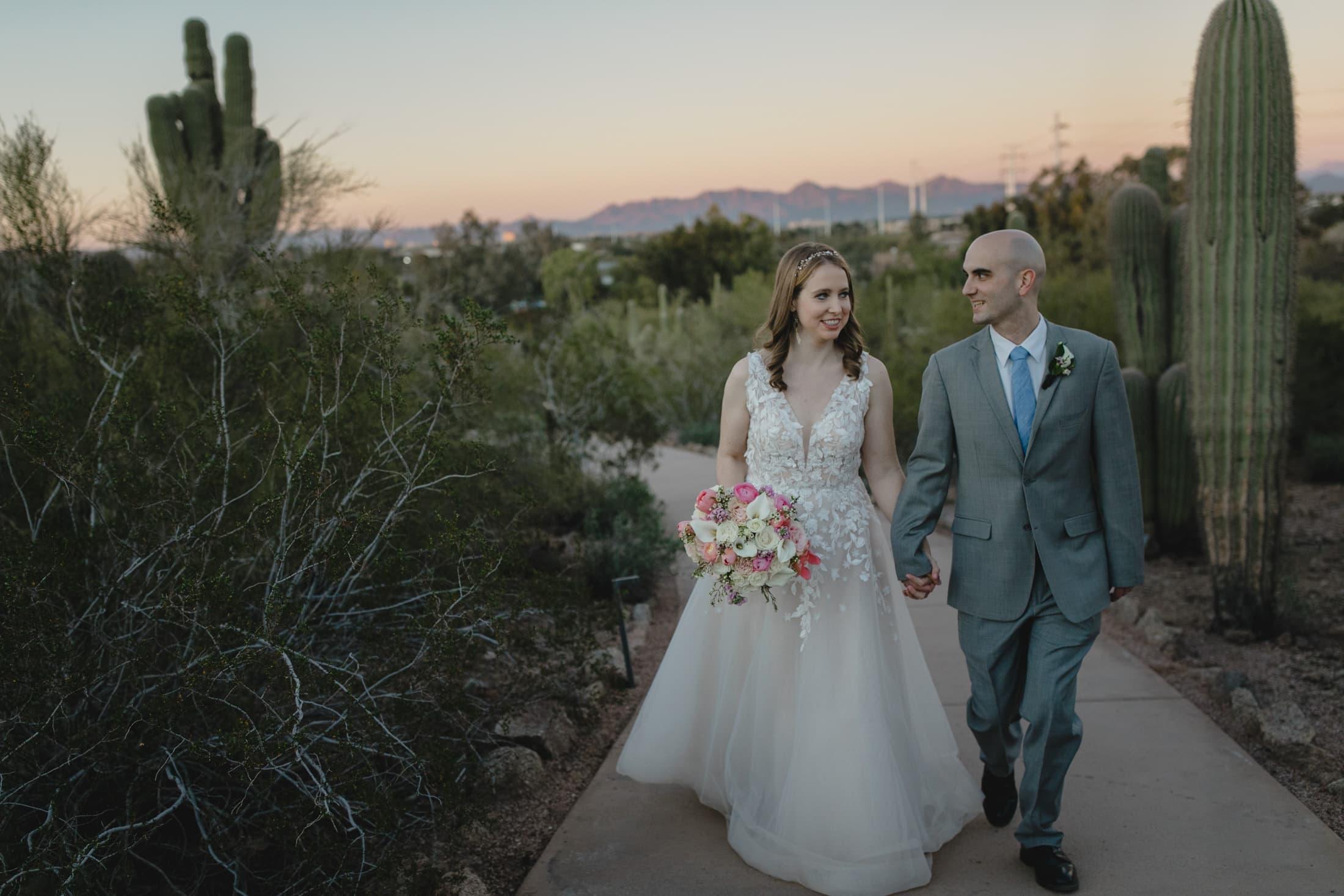 Desert Botanical wedding bride and groom walking on path