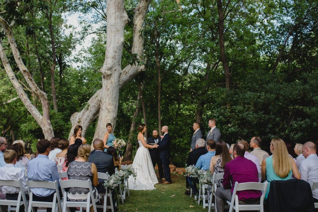 LAuberge small wedding in front of trees creekside
