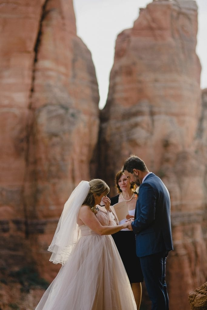 Bride cries a tear while eloping with groom in Sedona