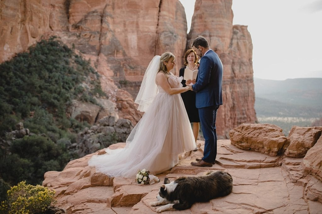 Sedona wedding ceremony at Cathedral Rock with dog and officiant