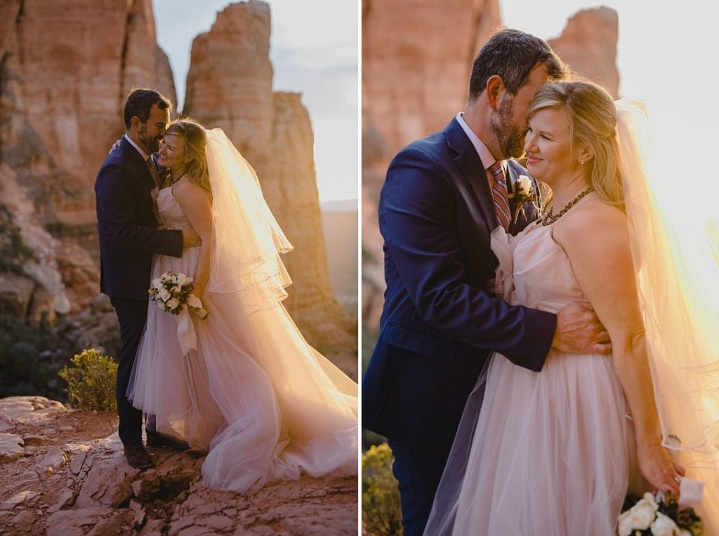 Bride and groom hug and laugh during their wedding photos at Cathedral Rock at sunset