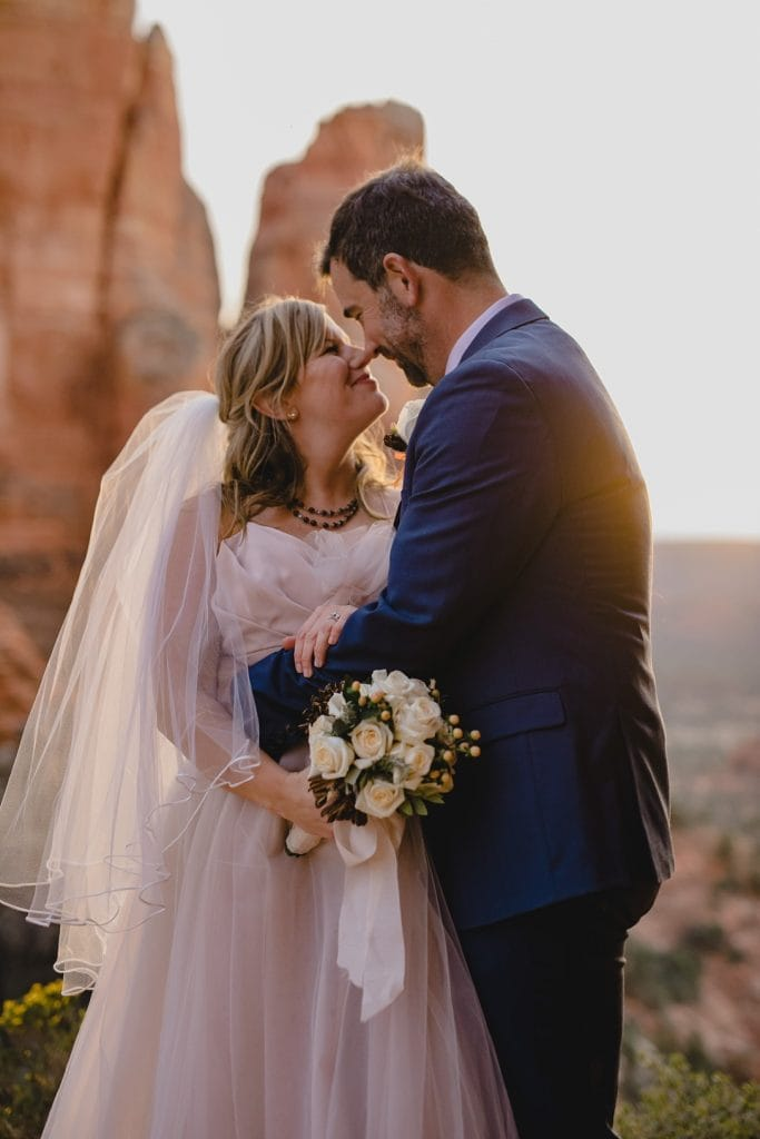 Bride and groom gaze into each others eyes after their Sedona elopement at sunset