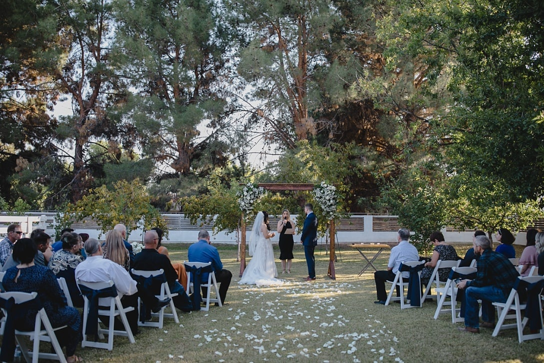 wedding ceremony at Modern Farm backyard wedding venue Gilbert with huge trees