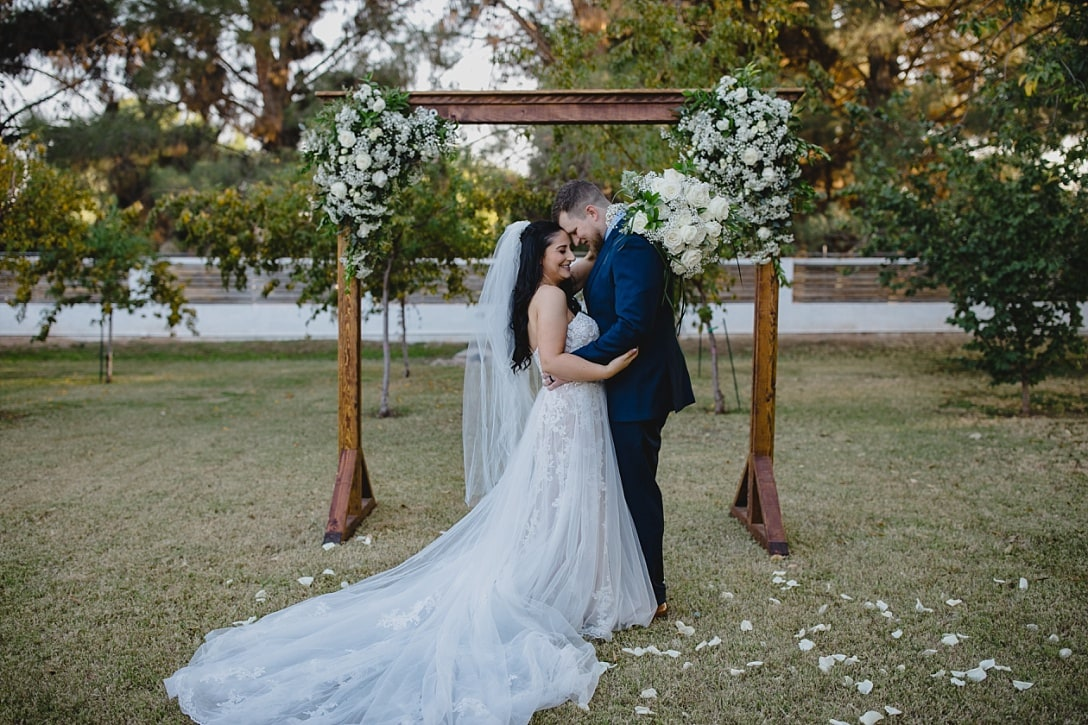 Gilbert AZ farm wedding venue bride and groom hugging