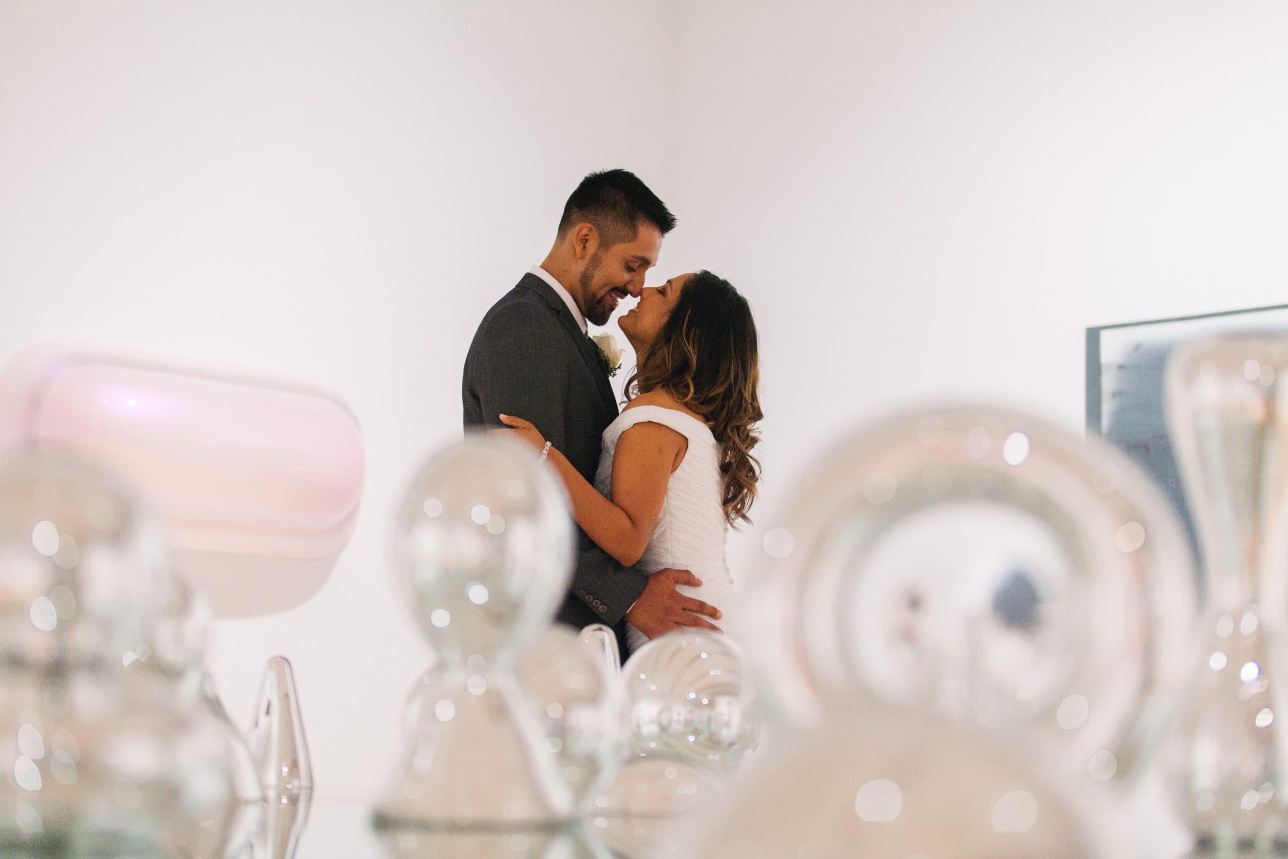wedding couple among glass art exhibit in Phoenix Art Museum