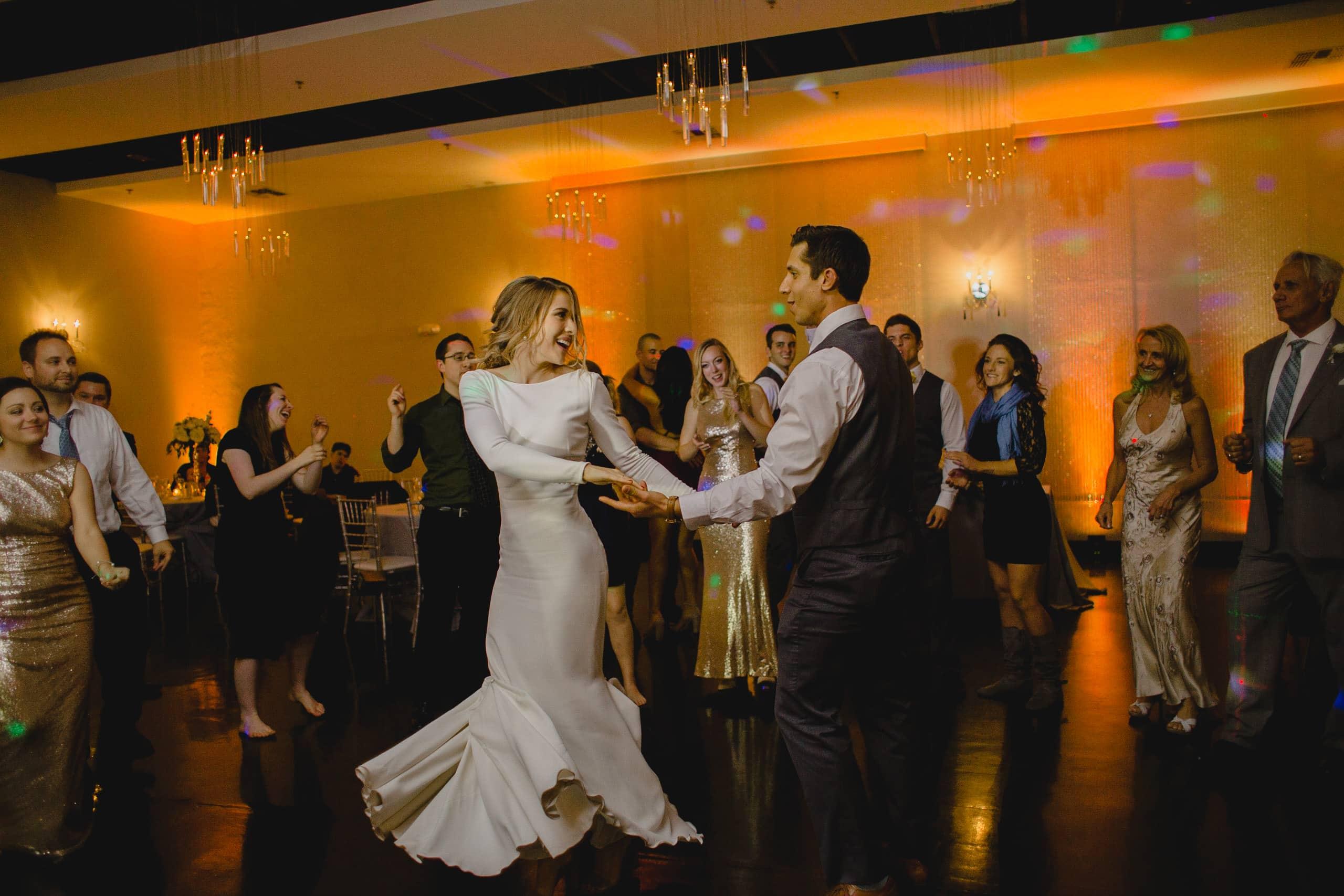 Soho63 wedding reception bride and groom dancing with amber uplighting