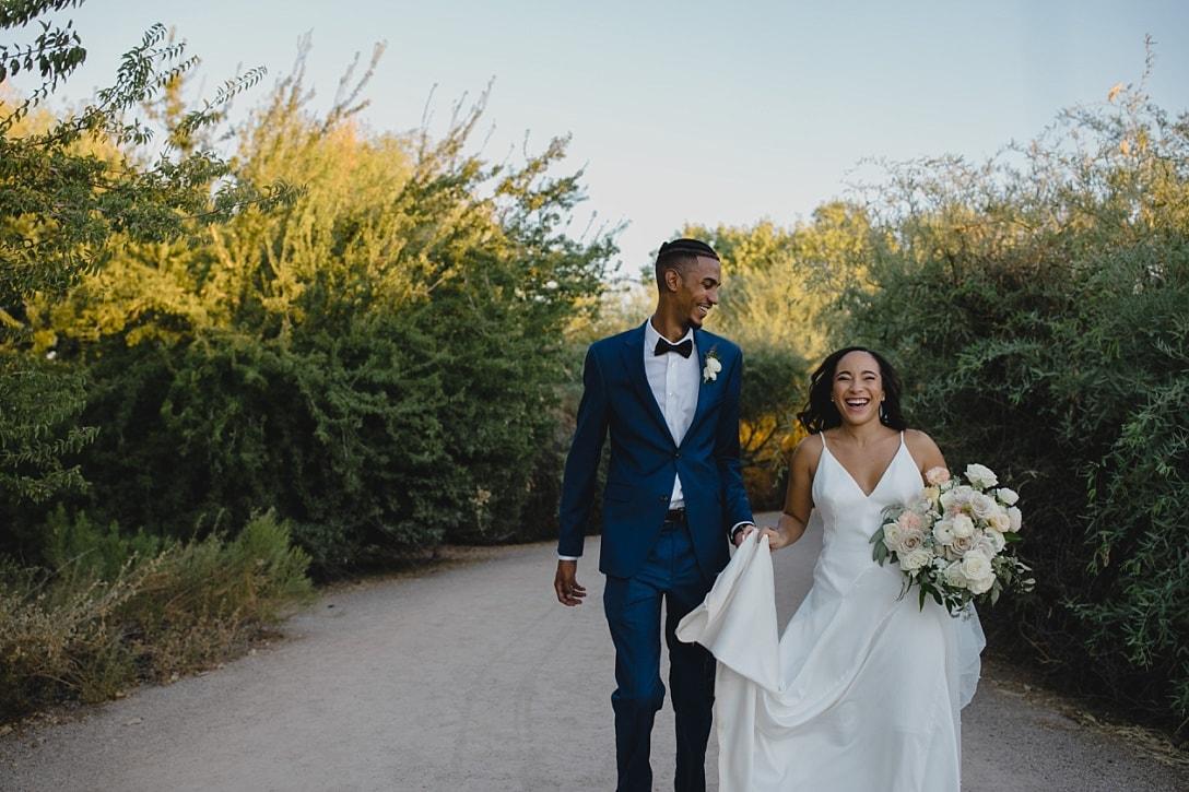 bride & groom running eloping at Gilbert Riparian Preserve